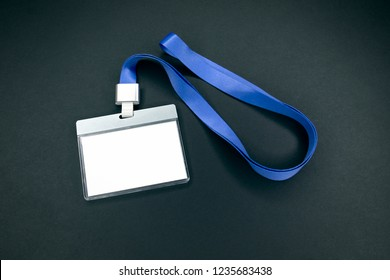 White empty staff identity mockup with blue lanyard. Name tag, ID card. Black background