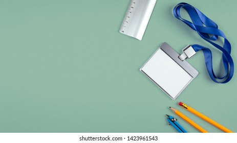 White empty staff identity mockup. Name tag, ID card. Minimal work space, flat lay photo of workspace desk