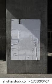 White empty street poster on concrete pillar
