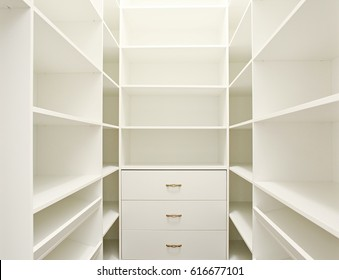 White empty walk-in closet.