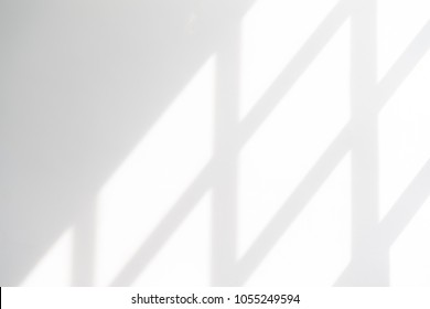 White empty wall with window shadow , perspective