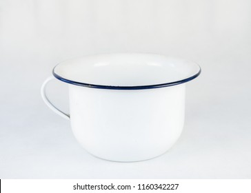 White enamled metal chamer pot