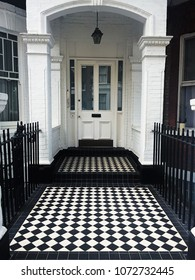 White english porch in London with black&white tiled floor