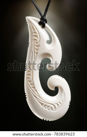White Engraved Fish Hook Bone Pendant Stock Photo Edit Now