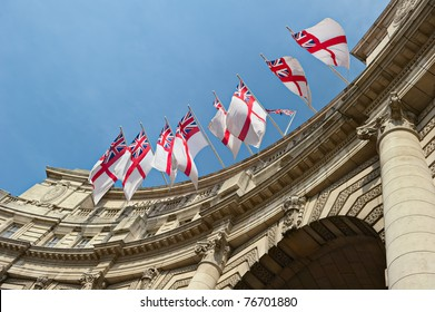 White Ensign flags flying on Admiralty Arch, London, England, UK