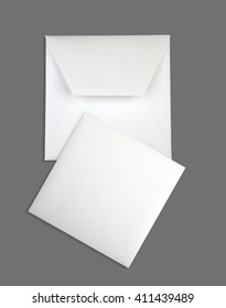 White envelope and card on black background
