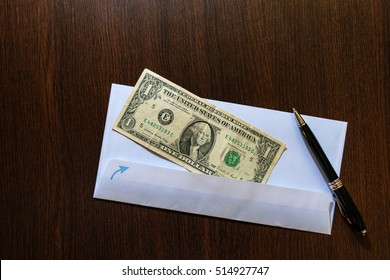 White envelope with one dollaar