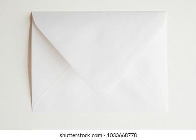 white envelope over white background