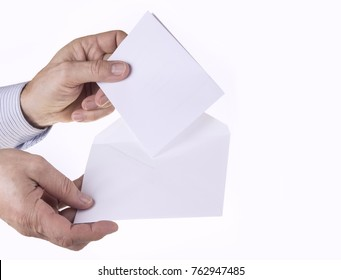 White envelope with paper note with man hand on the white background