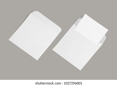White envelope and post card on a background, top view.