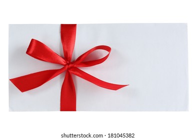 White envelope with red bow on white background