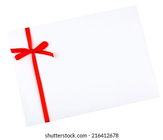 White envelope and red ribbon isolated on white