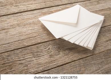 White Envelopes On A Wood Table