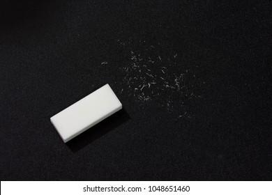 White eraser scrap  on  background.  Error Eraser dust on black background.  top view.