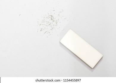 White eraser scrap  on  background.  Error Eraser dust on white background.  top view.