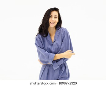 A white European woman  in blue work clothes standing with her arms folded for a photo shoot. Caucasian Woman Beautiful Portrait Studio On White Background