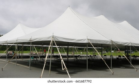 white events tent with chairs being put into place