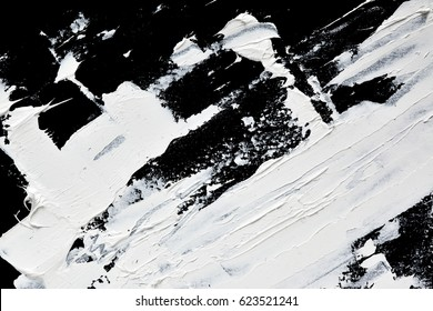 White expressive brush strokes of oil paint close up on black background