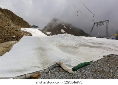 White fabric covering leftover snow on Stubai glacier to prevent snow to melt during summer in Tyrol, Austria