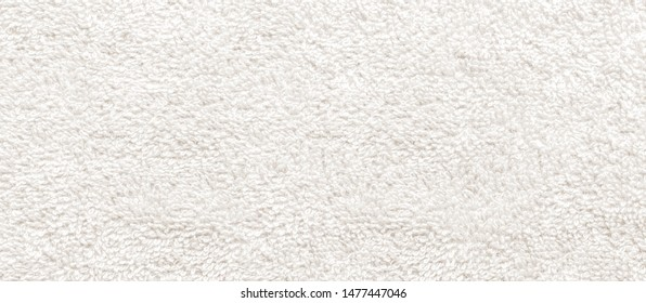 white fabric and texture concept - close up of a towel terry cloth