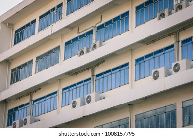 white facade and windows of an office building