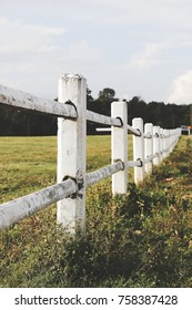 White farm fence boundary on mountain with grass field. Boundary separate concept.