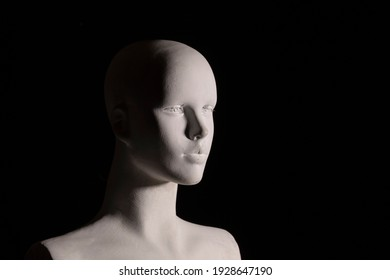 A White female manikin portrait with black background. Arts, anatomy and photography concept