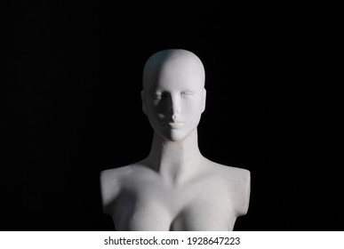A white female manikin portrait with black background and soft shadows. Art, model and photography concept