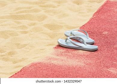 White female slaps lie on edge of childrens sandbox