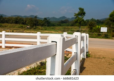 White fence near the road in the countryside