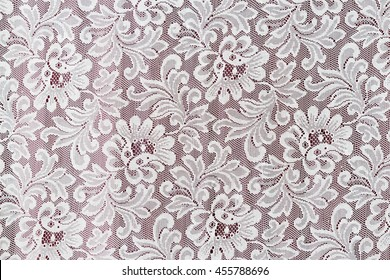 White fine elegance lace texture with seamless beautiful vintage floral abstract pattern. The part of window curtain for background and wallpaper