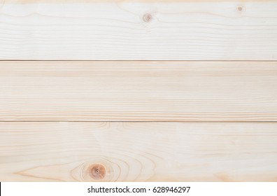 White Finland pine wood woodgrain texture background in natural beige brown color