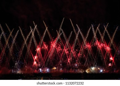 White fire fountains streams and red cycles of firework display in the night sky over Trinity bridge on the river Neva at Scarlet Sails festivity in Saint Petersburg ,Russia