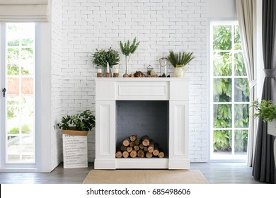 white fireplace in light room with Christmas decoration