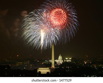 White fireworks explode over the United States Capitol