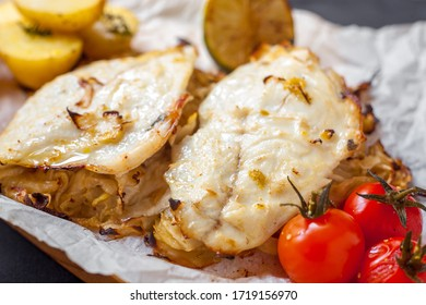 White fish fillet with cherry tomatoes and potatoes
