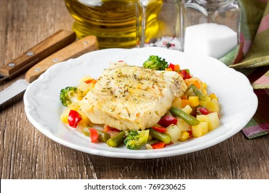 White fish fillet with vegetable stew,  healthy food, delicious homemade lunch