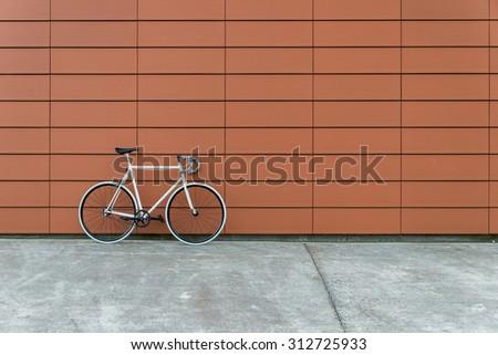 White Fixie Bike On Orange Wall Stock Photo Edit Now 312725933