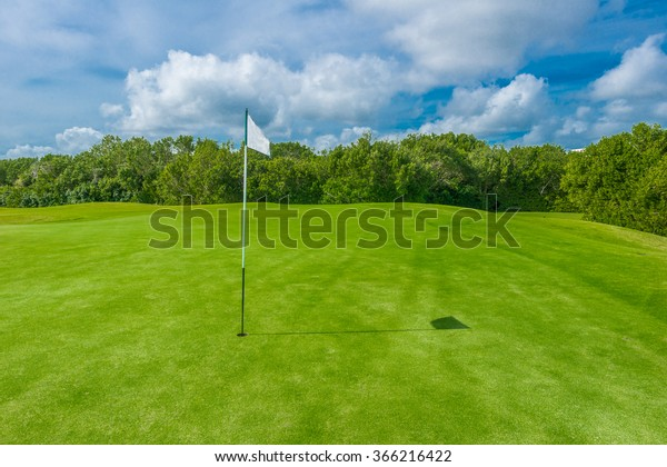 White flag and sand bunkers at the beautiful golf course.