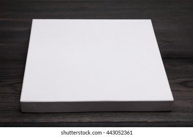 white flat box on black table