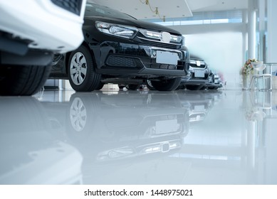 White floor for new car parking, new car pictures in the showroom, park, show waiting for sales of branch dealers and new car service centers.