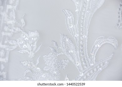 White floral lace embroidered texture textile macro close up background