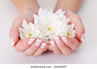 white flower with hands on white background