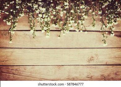 White flower on grunge wood board background with space.
