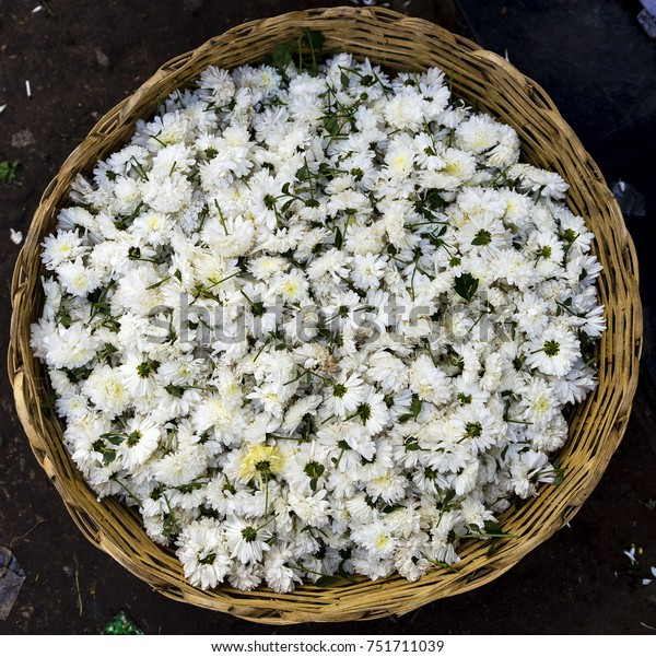 White flowers in a basket on an Indian flower market in Madurai, India