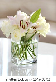 White flowers in a glass vase .