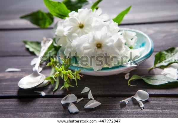 White flowers of jasmine on wooden background.Arabian jasmine flowers