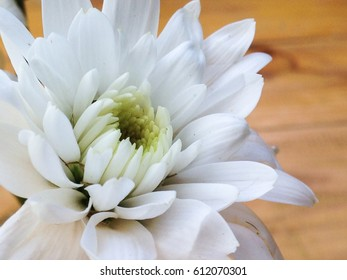 White flowers on brown table in resturant