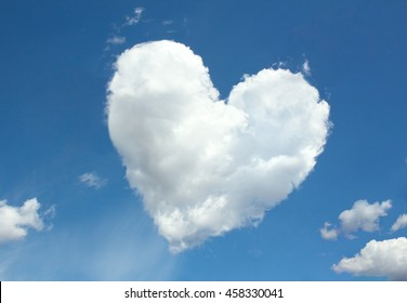 white fluffy cloud in heart shape form. conceptual illustration