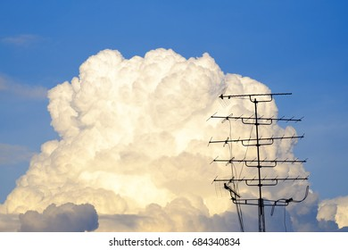 White Fluffy cloud on blue sky with TV Antenna